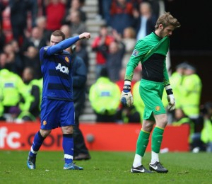 Rooney and De Gea trudge off the pitch in disappointment