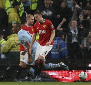 Scholes & Jones Look Dejected As Kompany Reels Away In Joy