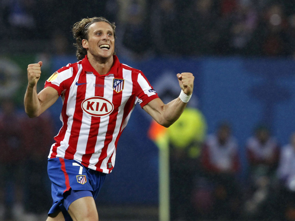Atletico Madrid's Forlan celebrates after scoring against Fulham during their Europa League final match in Hamburg